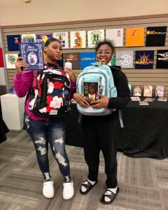Protege's posing with their new books and school supplies.