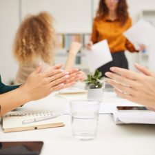 Unrecognizable businesswomen clapping hands after their colleagues presentation